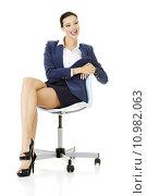 Купить «beautiful successful businesswoman sitting on ofice chair», фото № 10982063, снято 18 февраля 2020 г. (c) PantherMedia / Фотобанк Лори