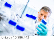 Купить «Senior male researcher carrying out scientific research in a lab (shallow DOF; color toned image)», фото № 10986443, снято 21 сентября 2018 г. (c) PantherMedia / Фотобанк Лори