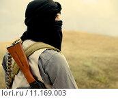 Купить «Muslim militant with rifle», фото № 11169003, снято 24 июня 2019 г. (c) PantherMedia / Фотобанк Лори