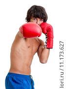 Купить «Young fighter posing with boxing gloves», фото № 11173627, снято 17 июля 2019 г. (c) PantherMedia / Фотобанк Лори