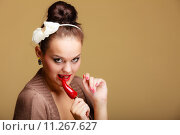 Купить «woman fashion girl retro style with chilli pepper. Flirtatious coquette», фото № 11267627, снято 19 ноября 2017 г. (c) PantherMedia / Фотобанк Лори