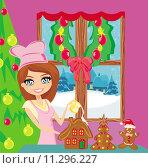 Купить «Portrait of happy young housewife decorating ginger house in chocolate glaze», иллюстрация № 11296227 (c) PantherMedia / Фотобанк Лори