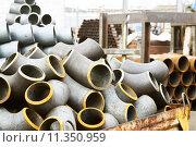 Купить «Трубы и отводы стальные», фото № 11350959, снято 8 февраля 2014 г. (c) Сергеев Валерий / Фотобанк Лори