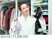 Attractive woman choosing seductive underclothing. Стоковое фото, фотограф Яков Филимонов / Фотобанк Лори