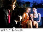 Купить «Flirtatious young girls staring at handsome guy», фото № 11359883, снято 19 ноября 2017 г. (c) PantherMedia / Фотобанк Лори
