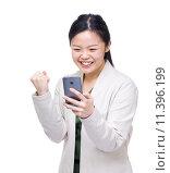 Купить «Asia woman feeling excited when reading message on mobile», фото № 11396199, снято 21 ноября 2018 г. (c) PantherMedia / Фотобанк Лори