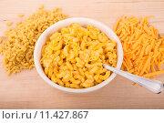 Купить «Dry Macaroni and Grated Cheese with Bowl of Mac n Cheese», фото № 11427867, снято 24 февраля 2019 г. (c) PantherMedia / Фотобанк Лори