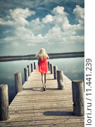 Купить «young woman with red dress at the sea», фото № 11441239, снято 17 февраля 2019 г. (c) PantherMedia / Фотобанк Лори