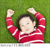 Купить «little smiling boy resting and hand up  in meadow», фото № 11460659, снято 17 августа 2018 г. (c) PantherMedia / Фотобанк Лори