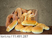 Купить «Composition with bread basket of different specialties», фото № 11491287, снято 24 мая 2019 г. (c) PantherMedia / Фотобанк Лори