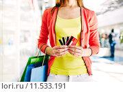 Купить «Customer with plastic cards», фото № 11533191, снято 22 февраля 2020 г. (c) PantherMedia / Фотобанк Лори