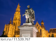 Купить «Antwerp - Statue of painter P. P. Rubens and tower of cathedral by Willem Geefs (1805-1883) in dusk», фото № 11539767, снято 24 апреля 2018 г. (c) PantherMedia / Фотобанк Лори