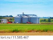 Купить «Agricultural silos in the fields, under blue sky», фото № 11585467, снято 22 мая 2019 г. (c) PantherMedia / Фотобанк Лори