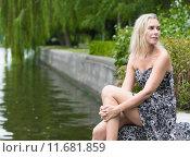 Купить «woman by the river», фото № 11681859, снято 21 июля 2019 г. (c) PantherMedia / Фотобанк Лори