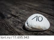 Купить «Table number ten written on a stone», фото № 11695943, снято 28 марта 2020 г. (c) PantherMedia / Фотобанк Лори