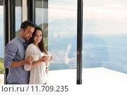 Купить «relaxed young couple at home», фото № 11709235, снято 20 сентября 2019 г. (c) PantherMedia / Фотобанк Лори