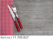 Купить «Knife and fork - bavarian country style table decoration on a wooden background», фото № 11709827, снято 20 июня 2019 г. (c) PantherMedia / Фотобанк Лори