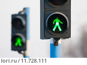Купить «Two green lights for pedestrians», фото № 11728111, снято 18 февраля 2019 г. (c) PantherMedia / Фотобанк Лори