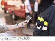 Купить «an interview with a firefighter», фото № 11746635, снято 20 сентября 2019 г. (c) PantherMedia / Фотобанк Лори