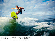 Купить «Male surfer riding on waves in the sea», фото № 11775607, снято 27 мая 2018 г. (c) PantherMedia / Фотобанк Лори