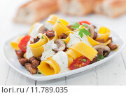 Купить «Italian egg noodles with tomato and mushroom», фото № 11789035, снято 22 мая 2018 г. (c) PantherMedia / Фотобанк Лори