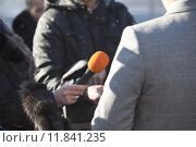 Купить «A journalist is making an interview with a microphone», фото № 11841235, снято 20 сентября 2019 г. (c) PantherMedia / Фотобанк Лори