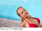 Купить «Blond woman in red bikini relaxing by pool», фото № 11895023, снято 19 сентября 2019 г. (c) PantherMedia / Фотобанк Лори