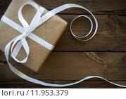 Купить «Gift With White Ribbon», фото № 11953379, снято 23 апреля 2018 г. (c) PantherMedia / Фотобанк Лори