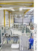 Купить «Worker operating machinery in factory that manufactures aluminium light fittings», фото № 11963027, снято 22 марта 2019 г. (c) PantherMedia / Фотобанк Лори