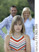 Купить «A girl looking upset from her parents.», фото № 11965999, снято 16 августа 2018 г. (c) PantherMedia / Фотобанк Лори