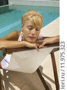 Купить «Woman sitting by the pool.», фото № 11975323, снято 19 сентября 2019 г. (c) PantherMedia / Фотобанк Лори