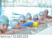 Купить «children group  at swimming pool», фото № 12025223, снято 19 сентября 2019 г. (c) PantherMedia / Фотобанк Лори