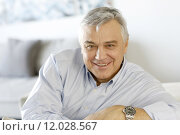Купить «Portrait of senior man relaxing in sofa at home», фото № 12028567, снято 23 апреля 2019 г. (c) PantherMedia / Фотобанк Лори