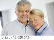 Купить «Portrait of cheerful senior couple at home», фото № 12028643, снято 17 июля 2018 г. (c) PantherMedia / Фотобанк Лори