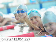Купить «group of happy kids children at swimming pool class learning to swim», фото № 12051227, снято 25 мая 2019 г. (c) PantherMedia / Фотобанк Лори