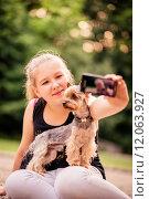 Купить «Selfie child and dog», фото № 12063927, снято 18 февраля 2019 г. (c) PantherMedia / Фотобанк Лори
