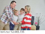 Купить «happy young family at home», фото № 12065735, снято 20 сентября 2019 г. (c) PantherMedia / Фотобанк Лори
