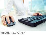 Купить «Female hand on computer mouse», фото № 12077767, снято 20 января 2018 г. (c) PantherMedia / Фотобанк Лори
