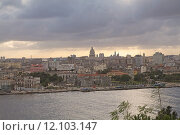 Купить «A panoramic view of Old Havana with the El Capitolio dome and the tower of Jose Marti memorial in the background, Havana, Cuba», фото № 12103147, снято 20 сентября 2019 г. (c) PantherMedia / Фотобанк Лори