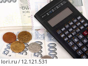 Купить «Czech money banknotes, coins and calculator», фото № 12121531, снято 27 июня 2019 г. (c) PantherMedia / Фотобанк Лори