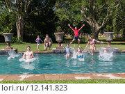 Купить «Girls Boys Swimming Pool », фото № 12141823, снято 19 сентября 2019 г. (c) PantherMedia / Фотобанк Лори