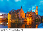 Купить «Cityscape with a tower Belfort from Rozenhoedkaai in Bruges at s», фото № 12161271, снято 24 января 2019 г. (c) PantherMedia / Фотобанк Лори