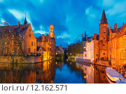 Купить «Cityscape with a tower Belfort from Rozenhoedkaai in Bruges at s», фото № 12162571, снято 24 января 2019 г. (c) PantherMedia / Фотобанк Лори