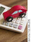 Купить «Red Toy Wooden Car On Calculator To Illustrate Cost Of Motoring», фото № 12186235, снято 21 октября 2018 г. (c) PantherMedia / Фотобанк Лори