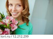 Купить «Woman with lilies», фото № 12212299, снято 31 мая 2020 г. (c) PantherMedia / Фотобанк Лори