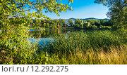 Купить «Лесное озеро дачный поселок на фоне гор», фото № 12292275, снято 6 июля 2015 г. (c) Сергей Лысенко / Фотобанк Лори