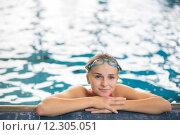 Купить «Female swimmer in an indoor swimming pool - doing crawl (shallow DOF)», фото № 12305051, снято 25 июня 2019 г. (c) PantherMedia / Фотобанк Лори