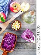 Купить «Fresh Cabbage and Apple Salad Ingredients on Table», фото № 12311135, снято 17 ноября 2018 г. (c) PantherMedia / Фотобанк Лори
