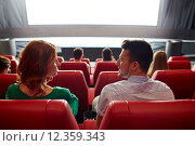 Купить «happy couple watching movie in theater or cinema», фото № 12359343, снято 19 января 2015 г. (c) Syda Productions / Фотобанк Лори