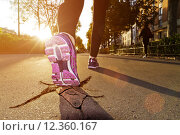 Купить «Woman running in the street», фото № 12360167, снято 13 ноября 2019 г. (c) PantherMedia / Фотобанк Лори